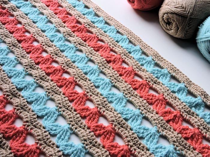 Zig Zag Hugs Lap Throw Crochet CrochetKim Free Pattern in Red Heart Yarns Baby Hugs Light #CrochetKim #Crochet #freecrochetpattern #redheartyarn #redheartyarns #babyhugs #throw #blanket #afghan